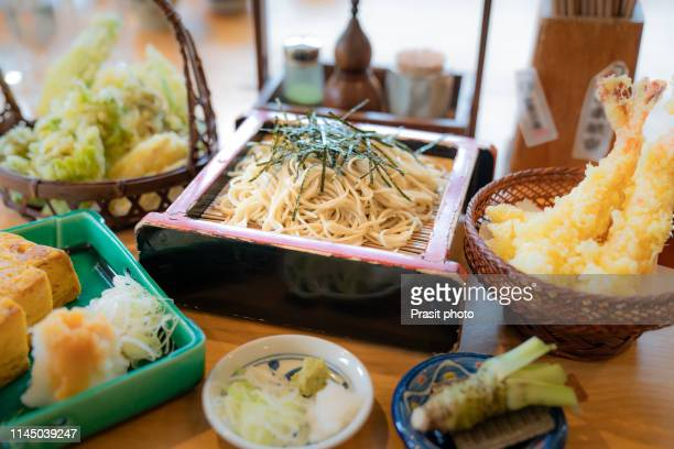 dipping style soba serve with tempura in japanese food restaurant. - soba stock pictures, royalty-free photos & images