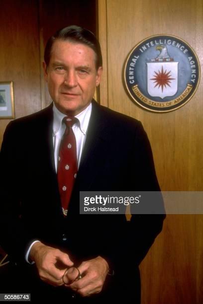 CIA Dir William Webster standing next to door w CIA seal