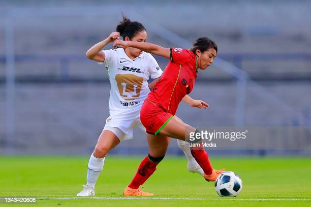 Dirce Delgado of Pumas fights for the ball with Celeste Vidal of Juarez during a match between Pumas and Juarez as part of the Torneo Grita Mexico...