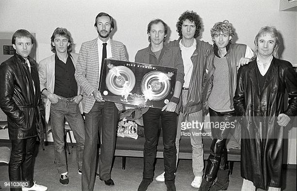 Dire Straits are presented with a gold disc awarded for sales of more than 100000 albums of Love Over Gold within 2 weeks of release in Holland LR...