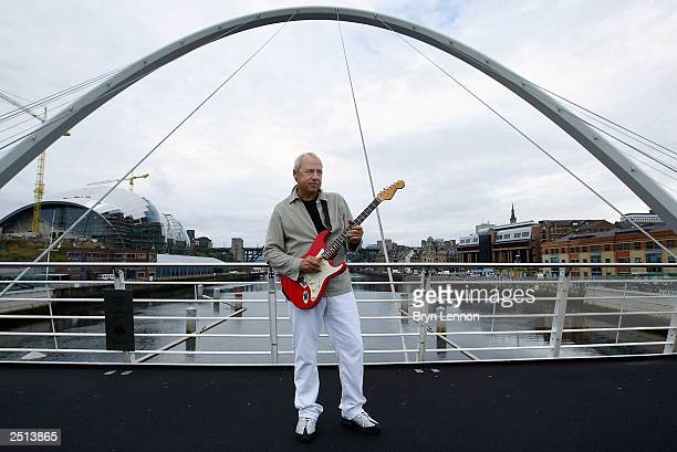 Dire Straits front man Mark Knopfler plays Local Hero on the Millenium Bridge on September 20 2003 in Newcastle England The song is the adopted theme...