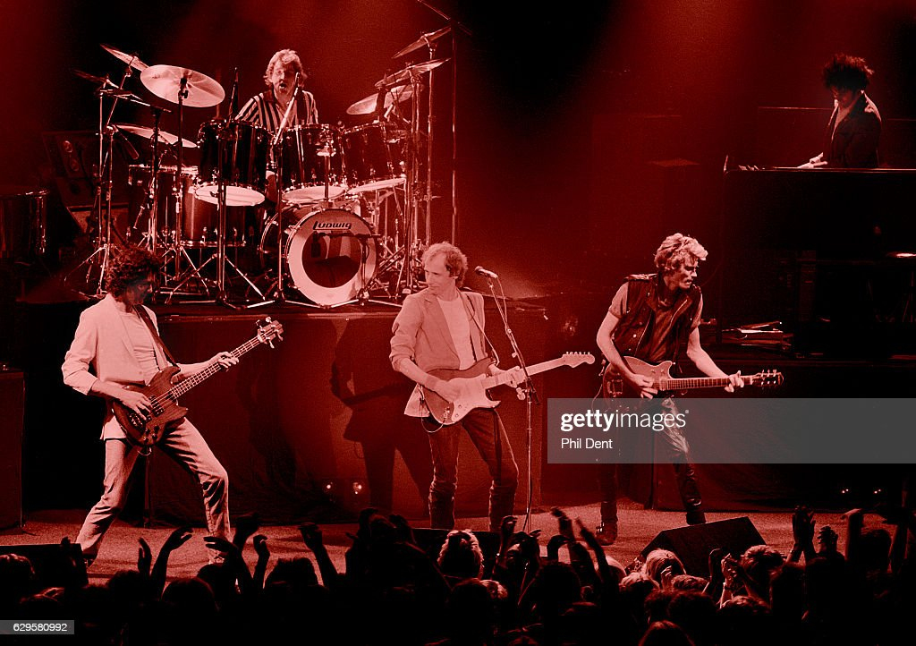 Dire Straits perform on stage in Guildford, 1982. L-R John Illsley, Terry Williams, Mark Knopfler, Hal Lindes, Alan Clark.