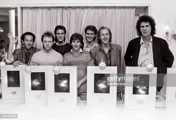 Dire Straits pose with their awards for the best selling compact disc in Holland in Rotterdam on May 25 1985 LR Jack Sonni Alan Clark Chris White...