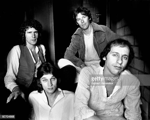 Dire straits posed in Amsterdam Netherlands in 1978 LR John Illsley David KnopflerPick Withers Mark Knopfler