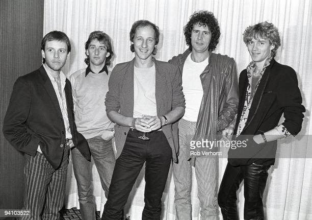 Dire Straits posed together at The Hilton Hotel Rotterdam Holland on October 14 1982 LR Alan Clark Terry Williams Mark Knopfler John Illsley Hal...