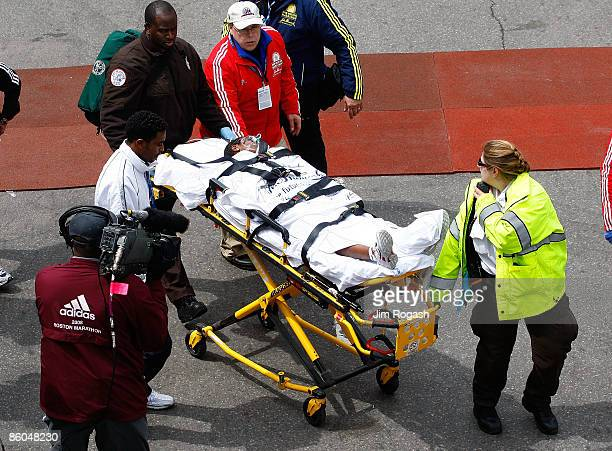 Dire Tune of Ethiopia receives treatment after collapsing after finishing second in the women's division of the 113th running of the Boston Marathon...