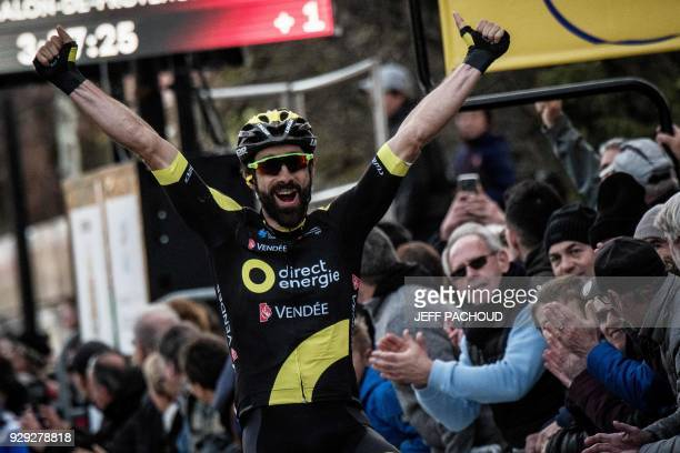 TOPSHOT Direct Energie team French rider Jerome Cousin celebrates as he crosses the finish line to win the fifth stage of the Paris Nice cycling race...