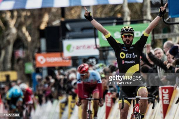 Direct Energie team French rider Jerome Cousin celebrates as he crosses the finish line to win the fifth stage of the Paris Nice cycling race between...