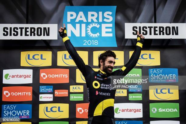 Direct Energie team French rider Jerome Cousin celebrates on the podium after he won the fifth stage of the Paris Nice cycling race between Salon de...