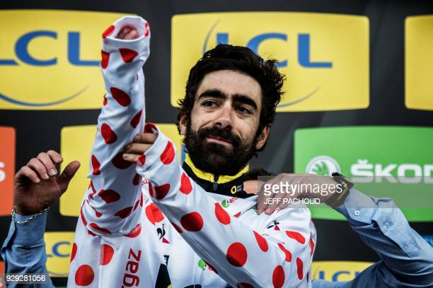 Direct Energie team French rider Jerome Cousin receives the Polka jersey on the podium after he wins the fifth stage of the Paris Nice cycling race...