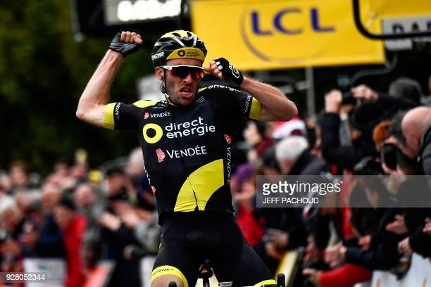 Direct Energie team French rider Jonathan Hivert celebrates as he crosses the finish line to win the third stage of the Paris Nice cycling race...