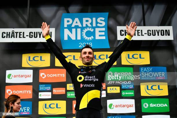 Direct Energie team French rider Jonathan Hivert celebrates on the podium after winning the third stage of the Paris Nice cycling race between...