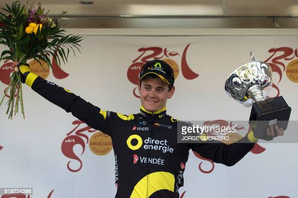 Direct Energie's French cyclist Thomas Boudat celebrates on the podium winning the first stage of the Ruta del Sol tour a 1976 km ride from Mijas to...