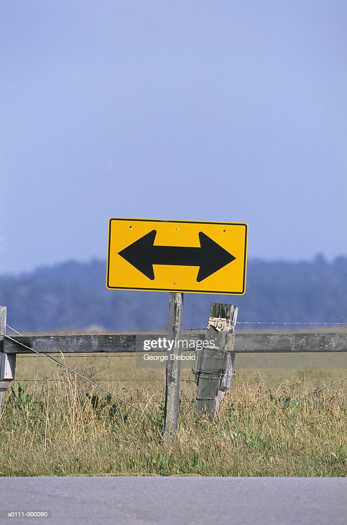 direction arrows on road sign stock photo getty images