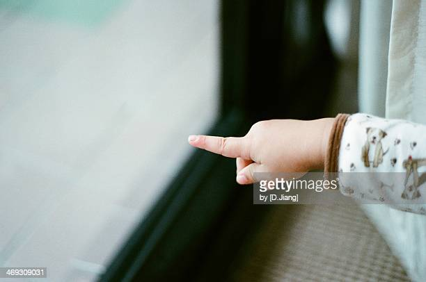 direction - baby pointing stock photos and pictures