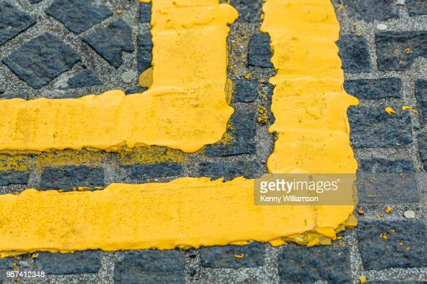 direction - double yellow line stock photos and pictures