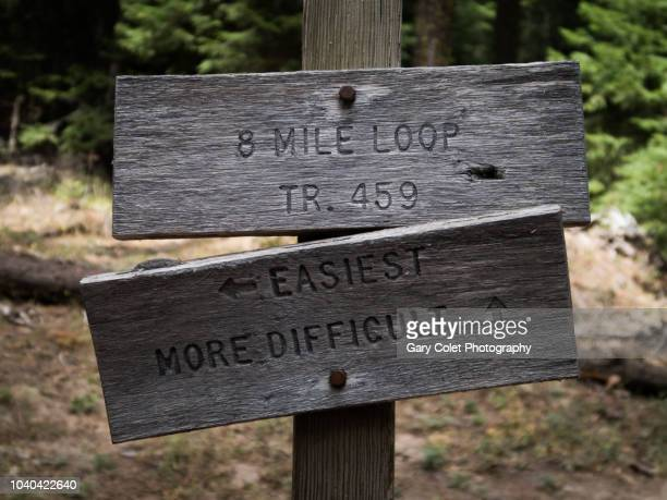 direction sign - difficult or easy route - gary colet stock pictures, royalty-free photos & images