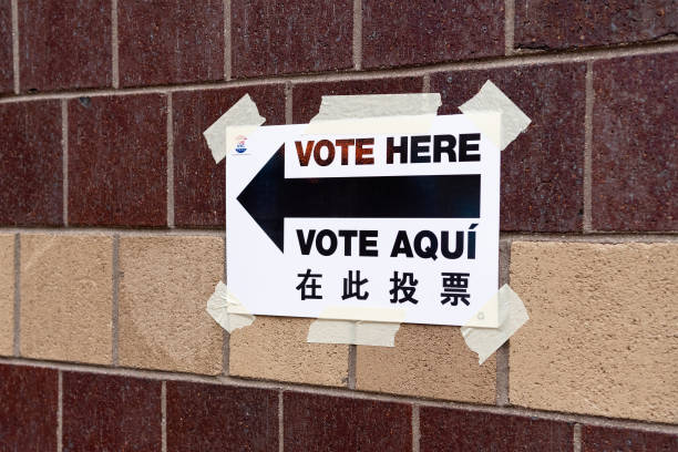a direction sign on where to vote from seen during the pictures
