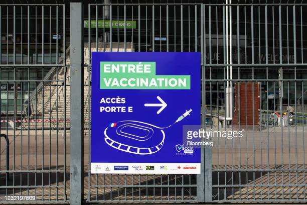 Direction sign outside the vaccination center at the Stade de France, France's national stadium, in Paris, France, on Friday, April 9, 2021. France...