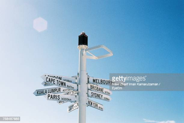direction signs against blue sky - directional sign stock pictures, royalty-free photos & images