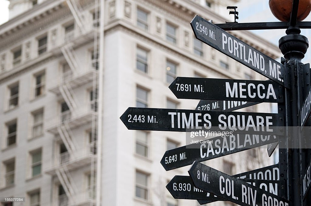Directional and distance signs in Pioneer Courthouse Square in Portland : Stock Photo