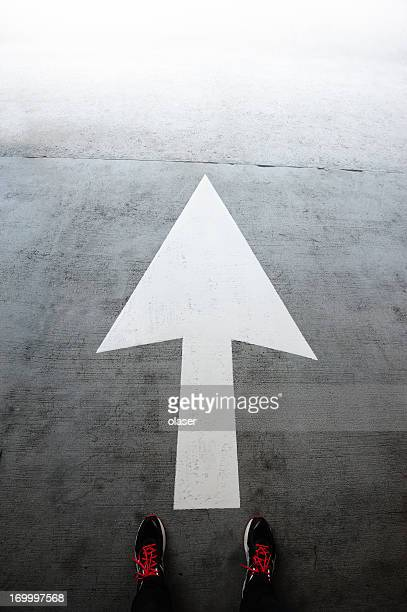 directional arrow pointing forward - following arrows stock pictures, royalty-free photos & images