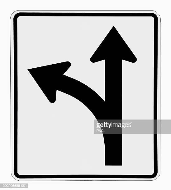 Directional arrows on road sign