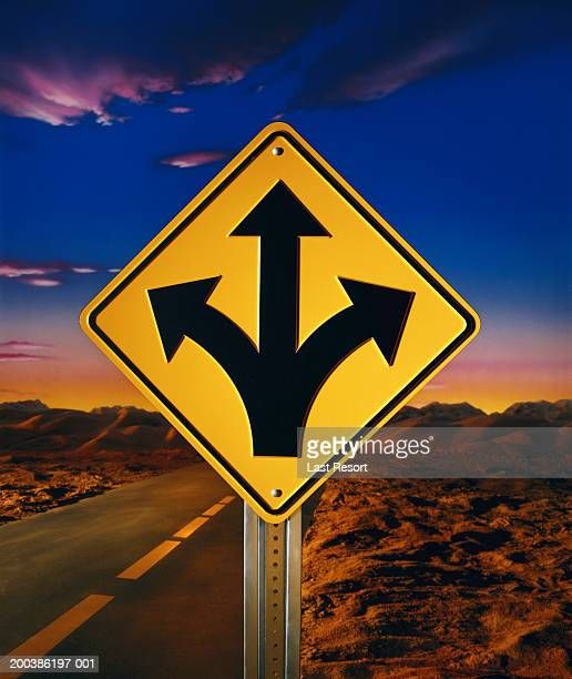 Directional arrows on road sign pointing three ways