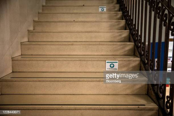 Directional markers sit on stairs to assist social distancing in a school for ages 3 to 18 as it prepares to reopen in Barcelona, on Thursday, Sept....