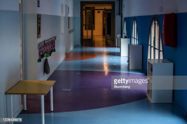 Directional markers sit on the floor in a corridor to assist social distancing in a school for ages 3 to 18 as it prepares to reopen in Barcelona, on...