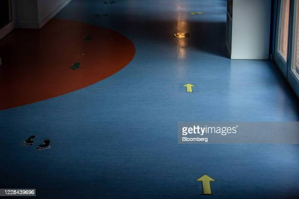 Directional markers sit on the ground to assist social distancing in a school for ages 3 to 18 as it prepares to reopen in Barcelona, on Thursday,...