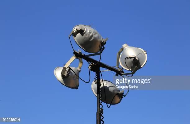 Directional outdoor lighting on a overhead mast pole