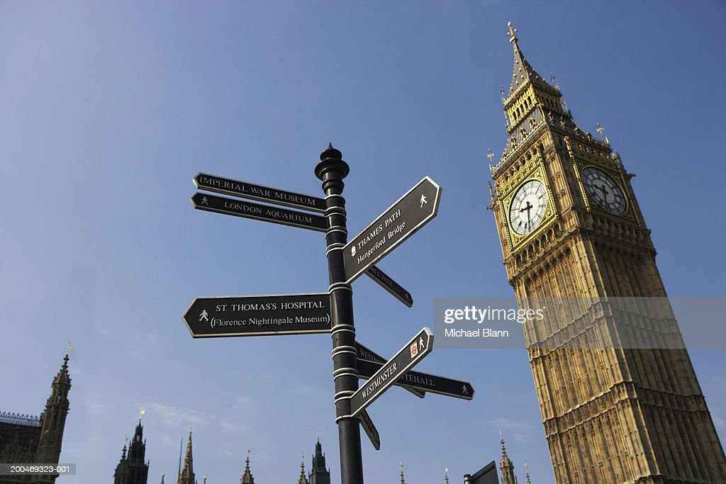 Directional road sign and Big Ben : Stock Photo