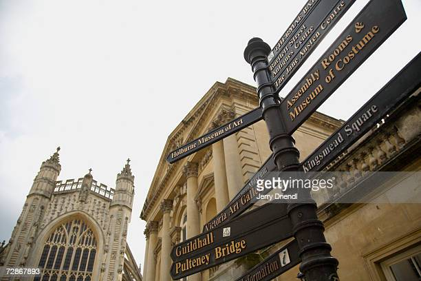 Directional sign at main square of Roman baths, low angle view