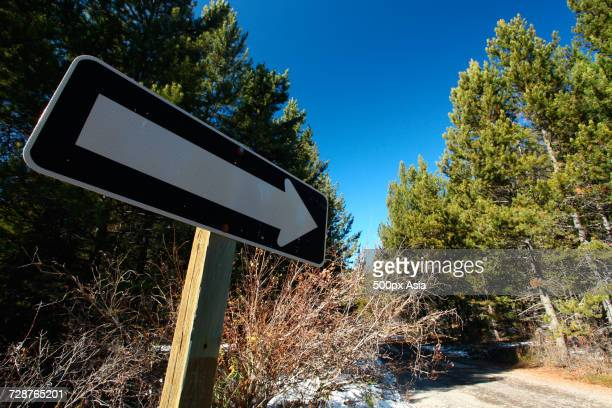 directional sign in natural scenery, canada - image stock pictures, royalty-free photos & images