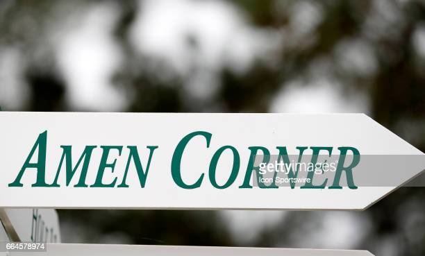 A directional sign points to Amen Corner during the first day of practice for the 2017 Masters Tournament on April 3 at Augusta National Golf Club in...