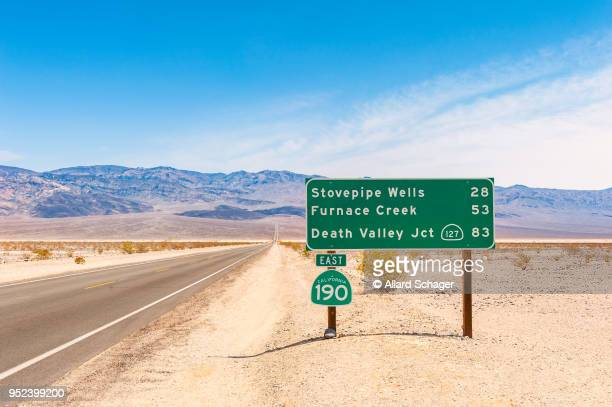 directional sign to destinations in death valley california usa - road sign stock pictures, royalty-free photos & images