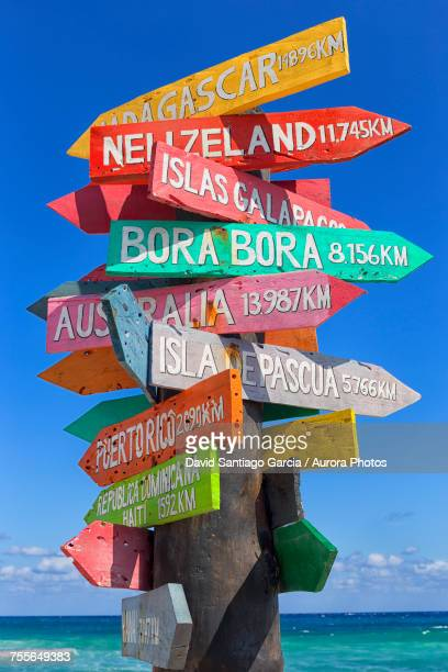 Directional sign with lots of directions, Punta Celarain, Punta Sur Ecological Reserve, Cozumel, Yucatan Peninsula, Mexico
