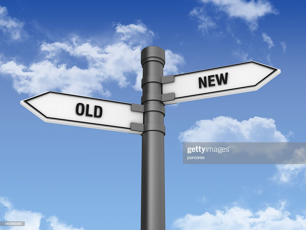 Directional Sign with OLD NEW Words and Sky : Stock Photo