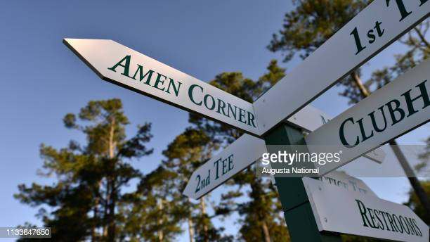 Directional signs point to Amen Corner during Practice Round 2 at Augusta National Golf Club on Tuesday April 5 2016