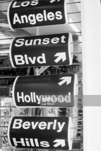 Directional signs pointing to Los Angeles Sunset Boulevard Hollywood and Beverly Hills