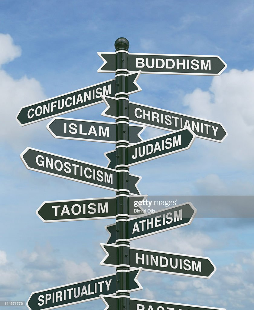 Directional signs pointing to various religions : Stock Photo