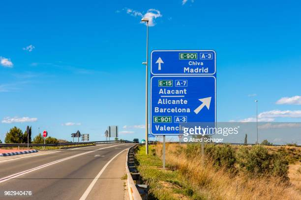 directional signs to madrid barcelona and valencia spain - road sign stock pictures, royalty-free photos & images