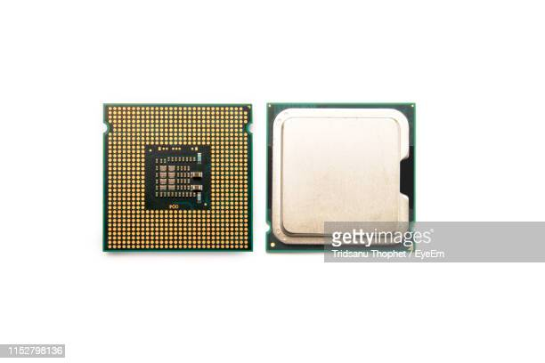 directly above computer chip against white background - computer chip stock pictures, royalty-free photos & images