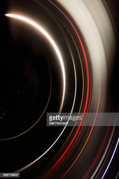 Directly above full frame shot of abstract light trails against black background