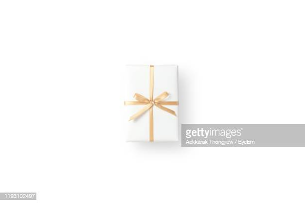 directly above of christmas gift over white background - gifts stock pictures, royalty-free photos & images