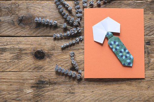 Directly above of Father's day greeting card. Origami shirt collar and necktie and lavender branch on rustic wooden background. Copy space. - gettyimageskorea