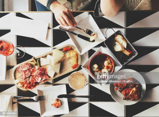 directly above of food on table - tapas stock photos and pictures