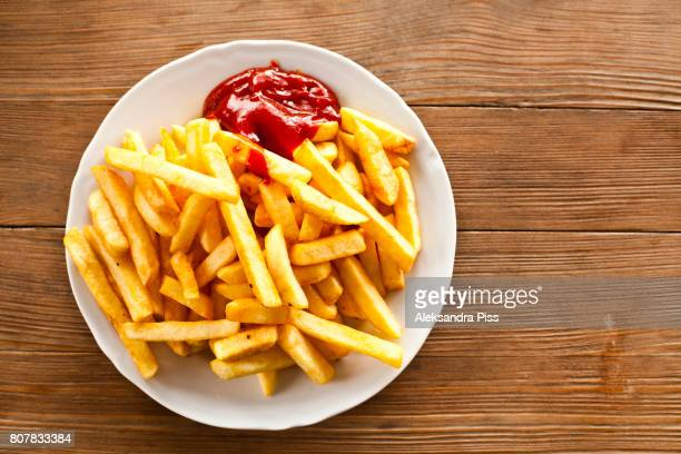 directly above of french fries with ketchup - fries imagens e fotografias de stock