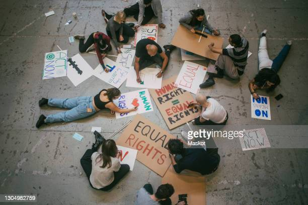 directly above of male and female protestor preparing posters for social movement - black lives matter stock pictures, royalty-free photos & images